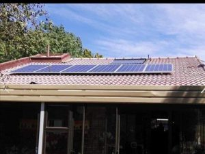 Solar Panels on top of a tiled roof home. Solar Man SA can help you with a custom Home Solar Power Solution for your home today. Contact us today!
