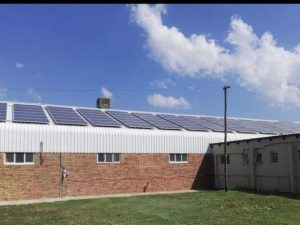 Solar Panels on top of a warehouse/ factory. Solar Man SA can help with your solution today. Contact us!